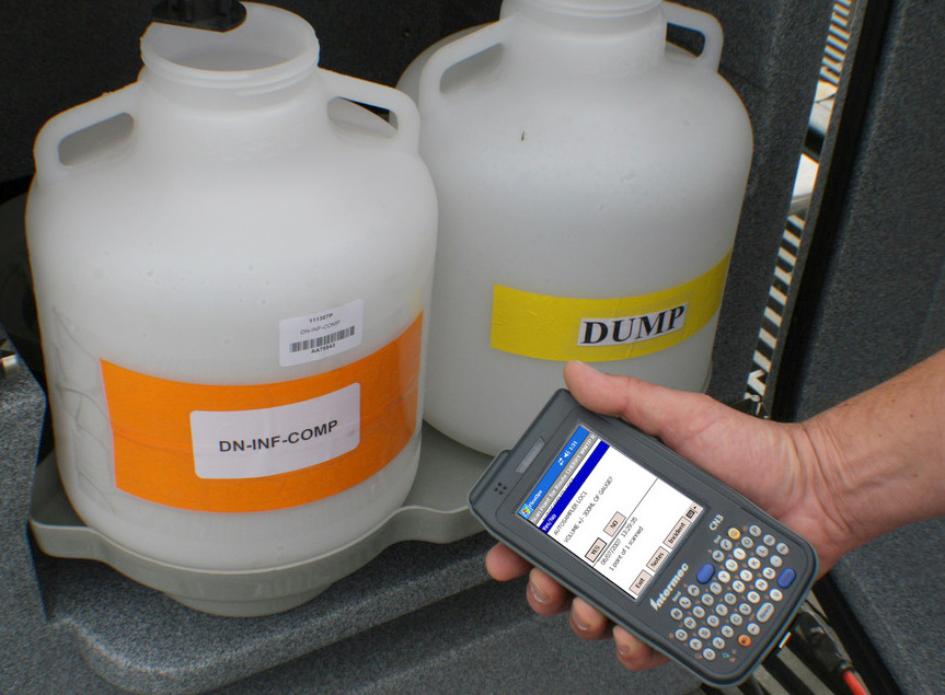 Sample bottles are scanned for chain of custody.