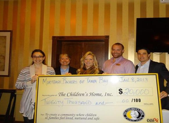 Mortgage Bankers of Tampa Bay presents check to The Children's Home