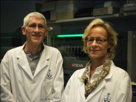 Corey Nislow and Guri Giaever with their Freedom EVO liquid handling workstation