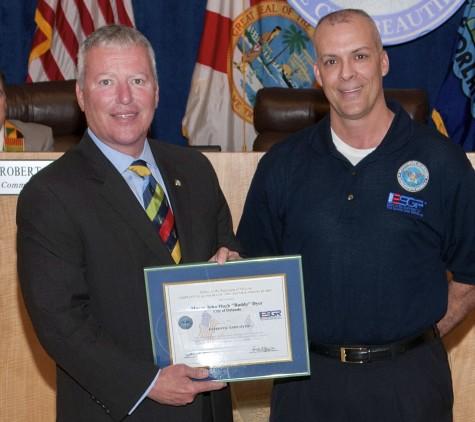 "James Dicks presents Orlando Mayor John Hugh ""Buddy"" Dyer with Patriot Award"