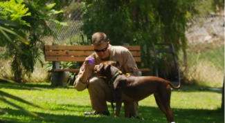Veteran Bonding with New Service Dog