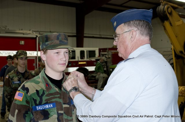 Lt. Col Sandy Sanderson promotes Cadet John Paul Baughman to Airman First Class.