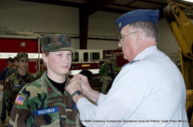 Lt. Col Sandy Sanderson promotes Cadet John Paul Baughman to Airman First Class.