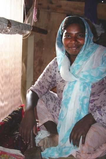 After a leg amputation, Parveen Bibi helps support her 3 children by rug making.