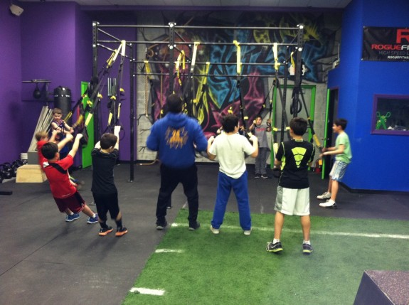 UFZ kids learn balance and coordination on the TRX straps