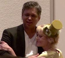 Panache and Rikka hug on stage at the 12-12-12 Global Gathering