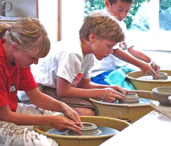 Day three of summer camp - the pottery wheel -- lots of fun!