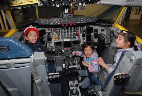 Children exploring cockpit where mom worked