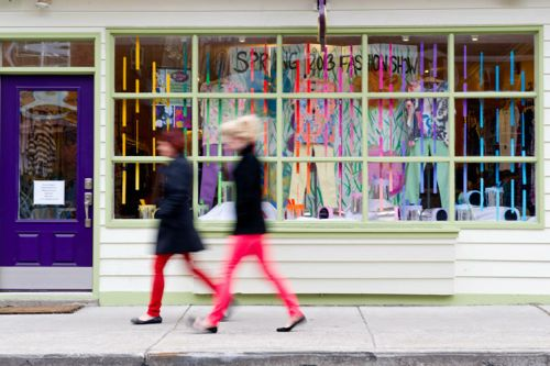 Customers pass by the Frox Spring Fashion Show Window in Ambler, Pa.