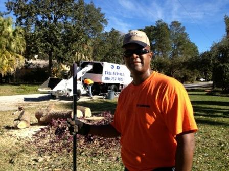 3D owner Darren Davis in a yard in Palm Coast with his additional equipment.