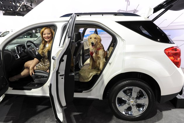 Charlotte Reed  with Hannah discussing pet travel at NY Auto Show