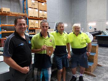 Robert Larder of JetSynergy presents plaque to Zodiac Milpro team