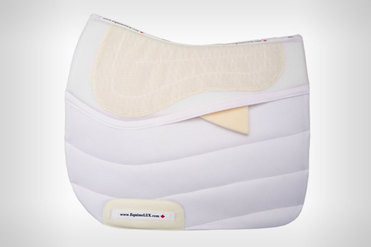 Dressage saddle pad with pockets for saddle fitting shims