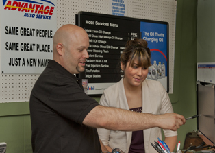 Advantage Auto Service owner Scott Santos advises a customer.
