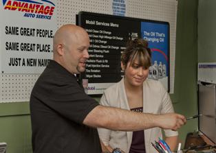 Advantage Auto Service owner Scott Santos advises a customer.