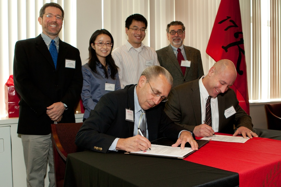 Carl Johnson, II-VI Foundation, and Anthony Nicotera, Rutgers, at IAMDN signing.