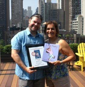 "Mony and Alberto in New York with ""I am Happy"" and award certificate"