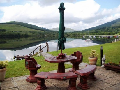 Picnic table at summer house in Briar Cottages garden Loch Earn