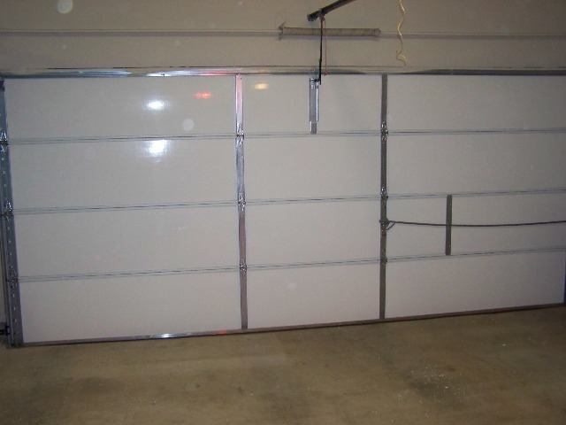 Energy efficient insulated garage doors can save on for Energy efficient garage doors