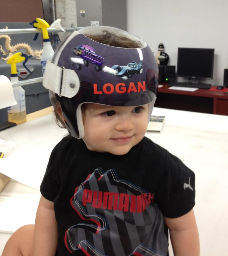 Logan wears his new Doc Band helmet wrap by Image 360 Boca Raton.