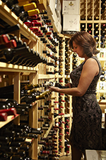 Mindy Reed, owner, in the wine cellar of Zin American Bistro in Palm Springs, CA