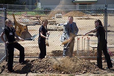 Students join Dr. Dummer for ceremonious shoveling at the construction site.