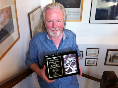 Author Peter May with the Barry Award for his novel The Blackhouse