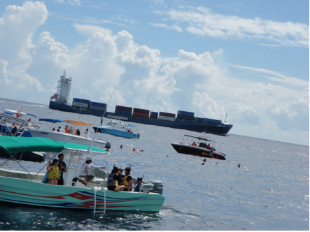 Large vessel in collision route toward tourist and boat area