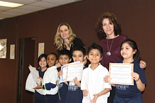 Principal Vicky Kleros with Students at Manuel Perez Elemetnary School