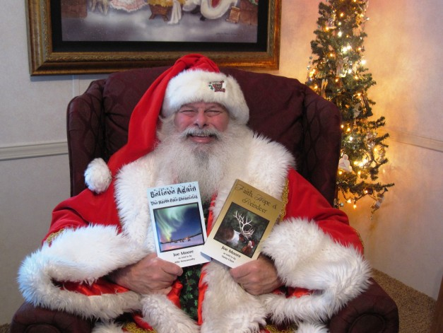 Santa Claus with his books that he will autograph