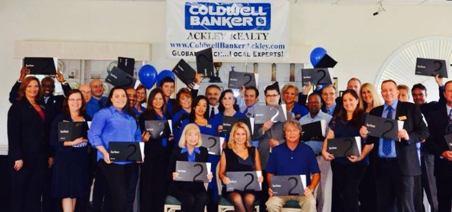 Ackley Realty's sales agents display their new Surface II tablets