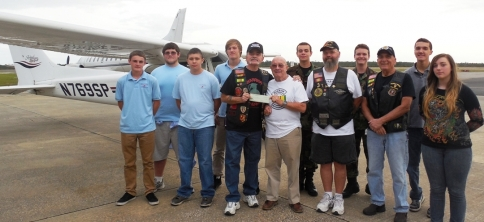 The Warrior Brotherhood MC presents at check to Teens In Flight.
