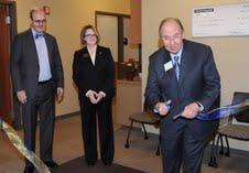 Provost Diacon, Dean Spake and John S. Brinzo cutting the ribbon