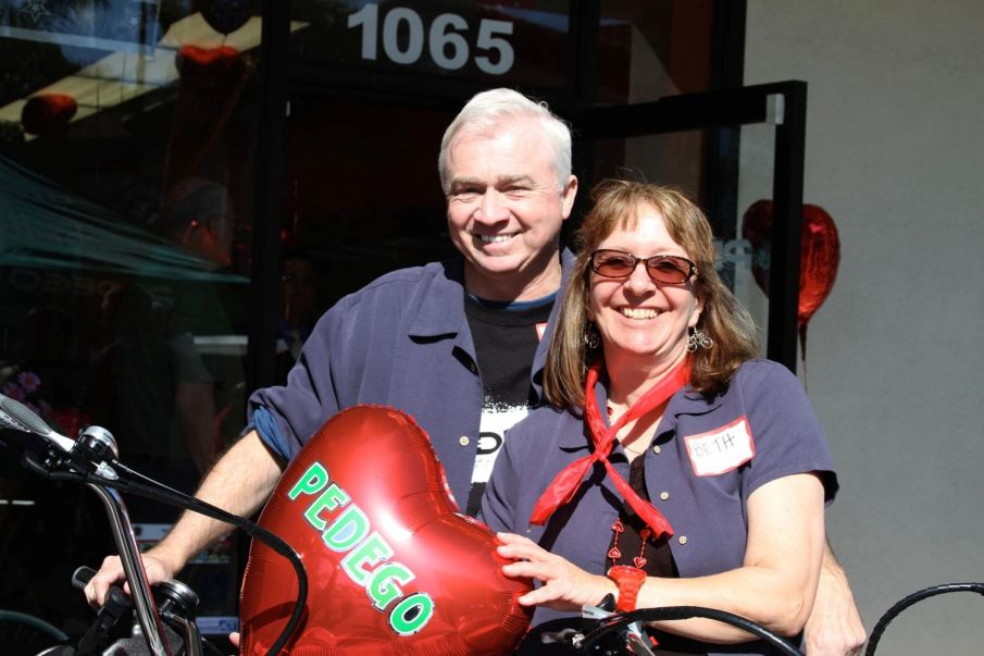 Co-owners Beth Black and Brian Ballard are celebrating at Pedego GLB.