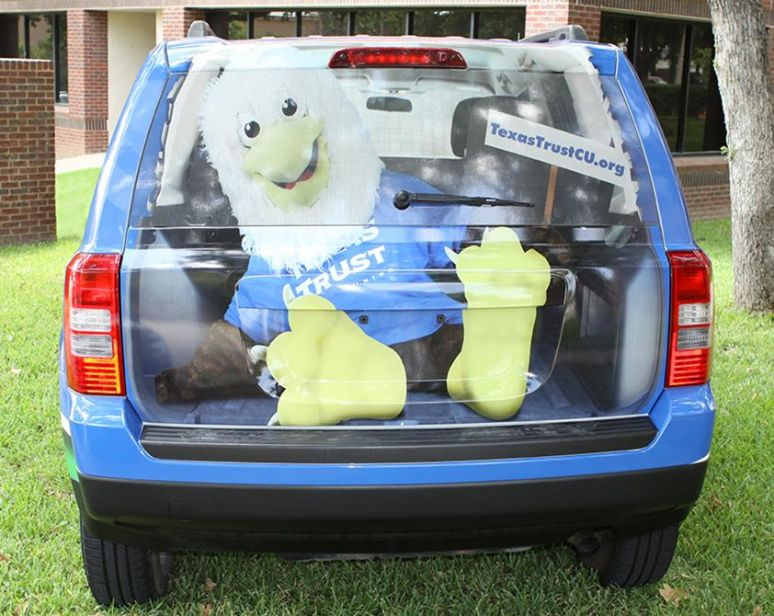 wrapped jeep creates illusion that cash is sitting in back of jeep. Cars Review. Best American Auto & Cars Review