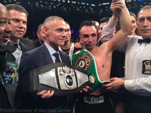 "Brett Yormark awarding ""Brooklyn's World Champion"" belt to Paul Malignaggi,"