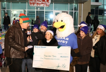 Amber Danford presents Toys for Tots a Check for $5,000