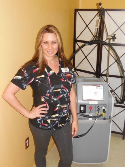 Joy next to the laser hair and pigmented and vascular lesions treatment machine.