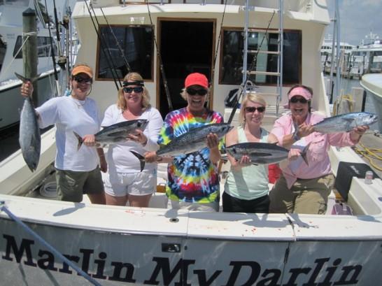 Women on Lady Pamela celebrate their catch.