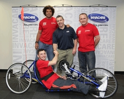 Invacare presents hancycle to Josh Davies, Colin Charvis and David Matthias