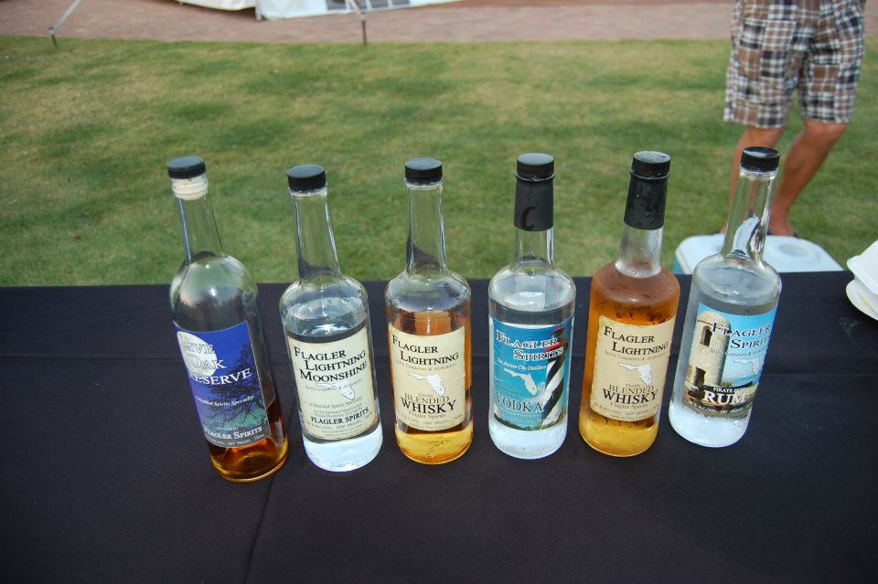 Flagler Spirits liquor products all lined up at a local event in Flagler County.