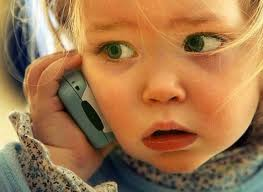 Young child using a cell phone.