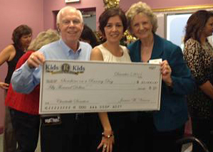 Kids 'R' Kids founders present Sunshine on a Ranney Day with $50,000 donation