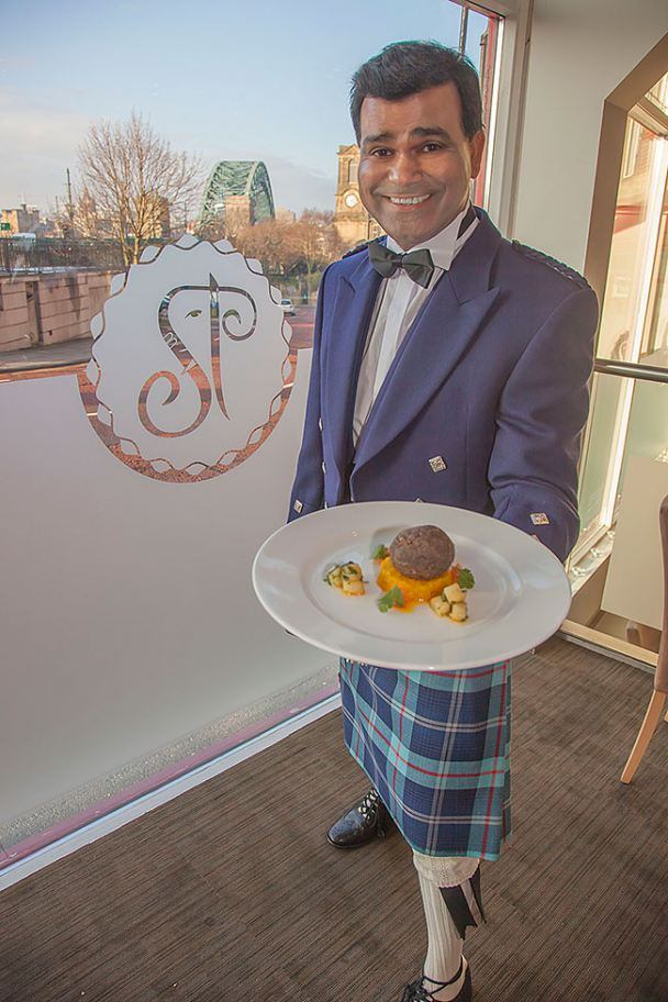 Avi Malik in full Scottish dress to launch his restaurant's haggis curry dish.