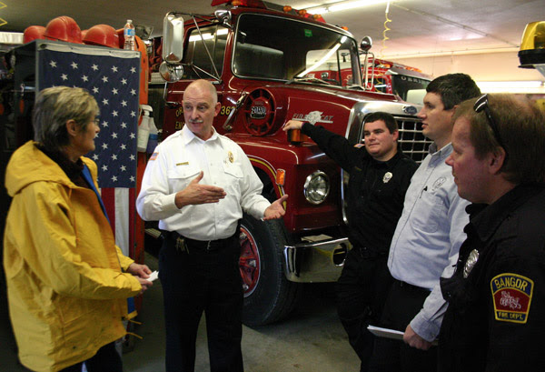 Dr. Shaw (left) discusses chemical exposure with the Bangor Fire Department