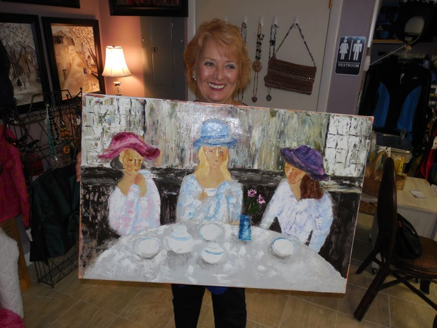 Le Cose Belle's Paul Felici holds one of her painting entitled Ladies Lunching.