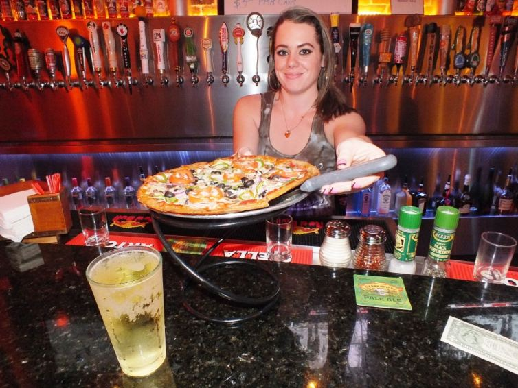 Bartender Serving Glute-Free Pizza and Cider Beer