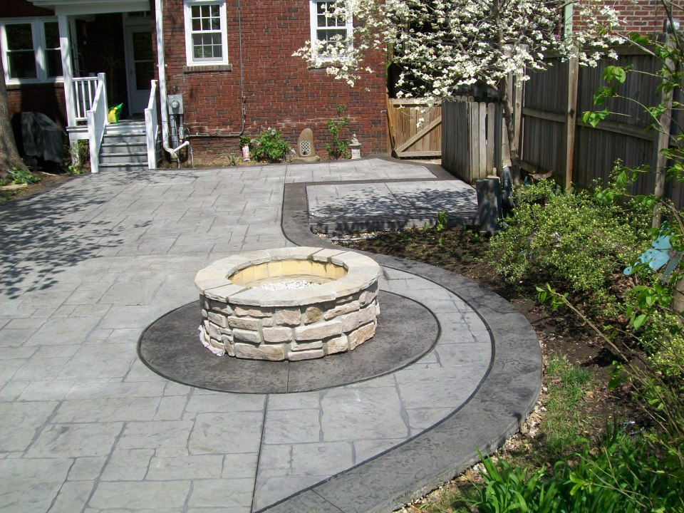 Stamped concrete patio with fire pit. Clayton Mo by T & H Foundations