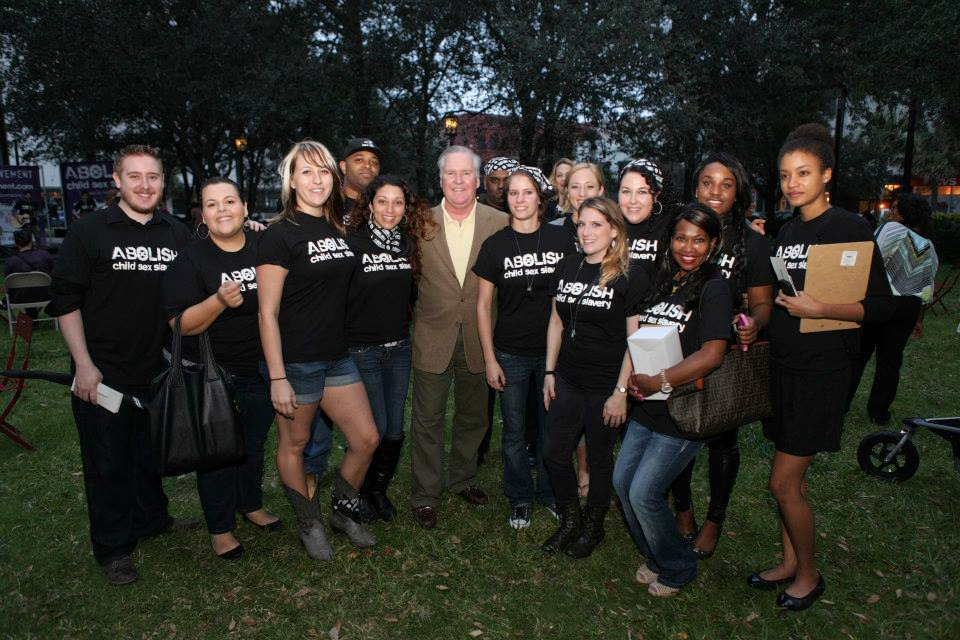 Members of the Abolish Campaign pose with Tampa Mayor Bob Buckhorn.