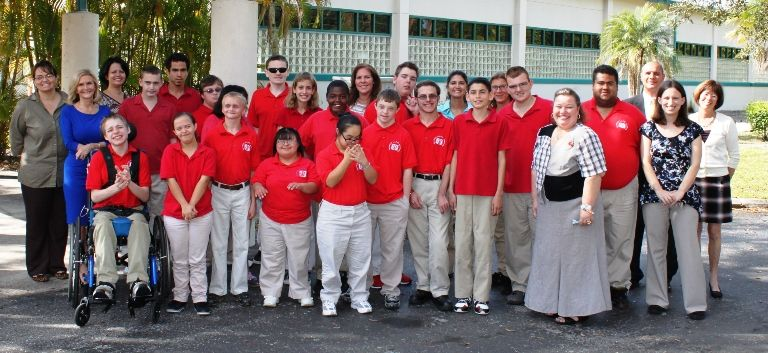 The L.I.F.E. Academy students and teachers in front of their new school